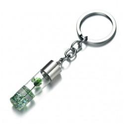 Porte-clés flacon avec fleur verte