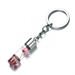 Porte-clés créatif flacon avec fleur rose sèche